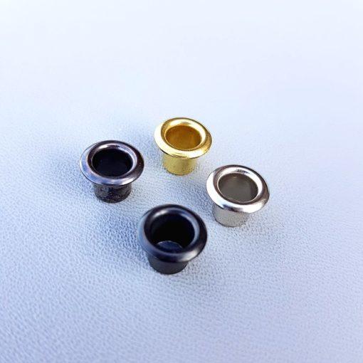 Nitar i fyra olika nyanser; svart, grå, guld och silver
