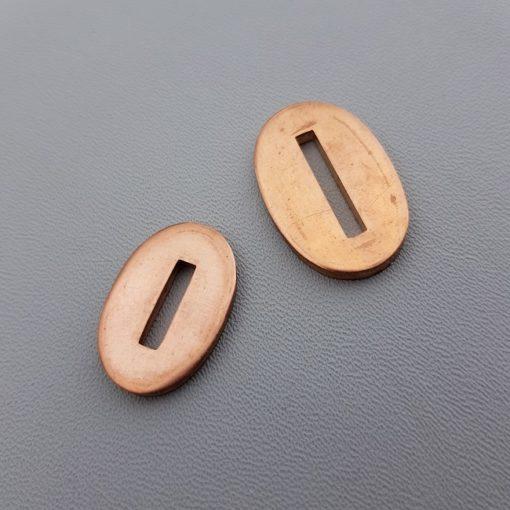 Bolster av brons i två olika storlekar