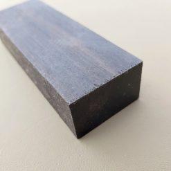 Ebenholts, svart träslag, knivskaft kortsidan